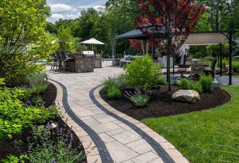 Walkway leading to a Beacon Hill Flagstone patio