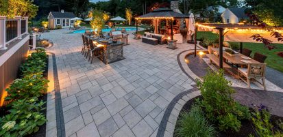 Evening shot of an Outdoor Living retreat built with Beacon Hill Flagstone pavers