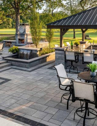 Outdoor Living with Umbriano elevated area and Lineo Dimensional Outdoor Kitchen