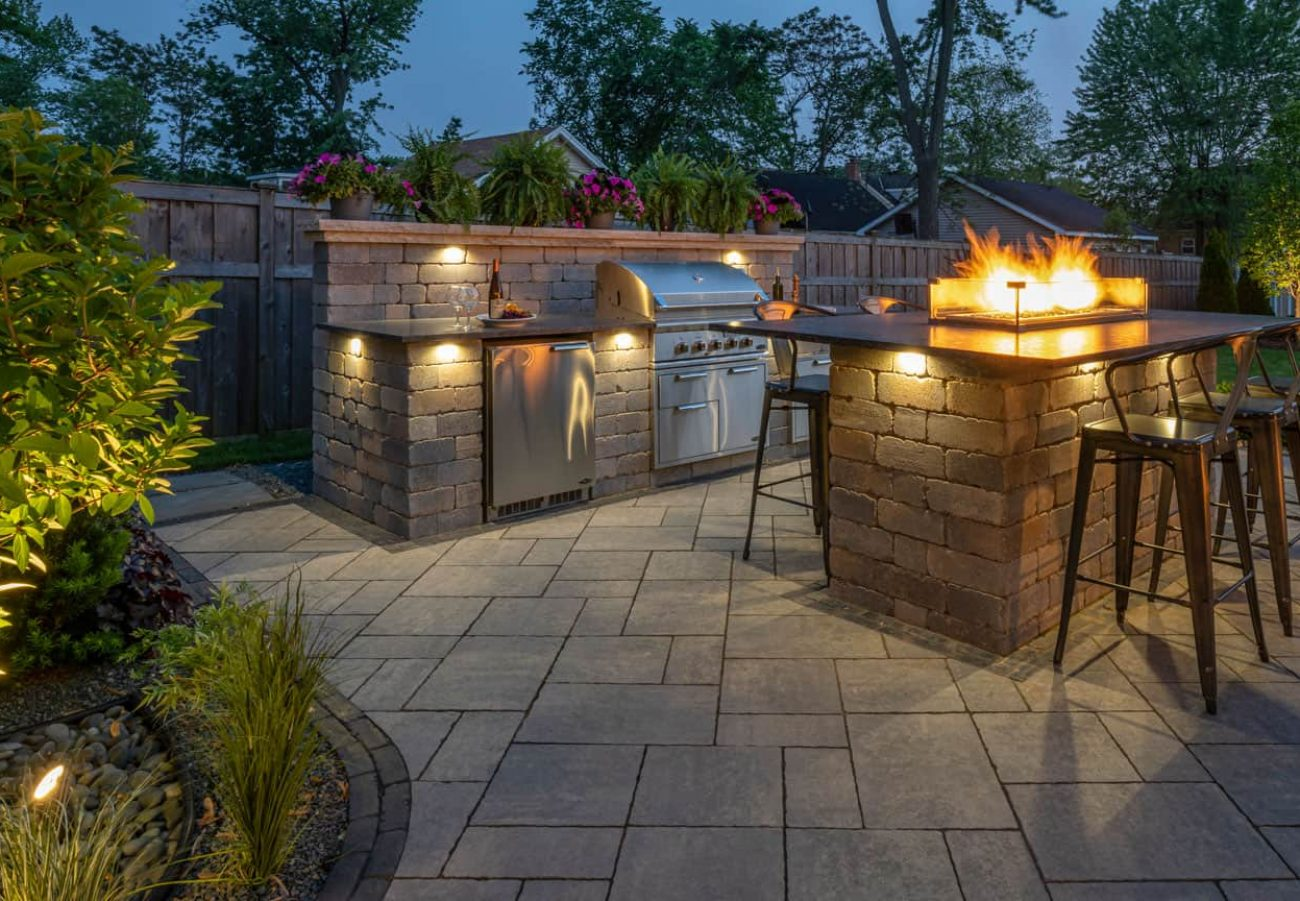 Evening shot of the Outdoor Kitchen built with Brussels Dimensional wall