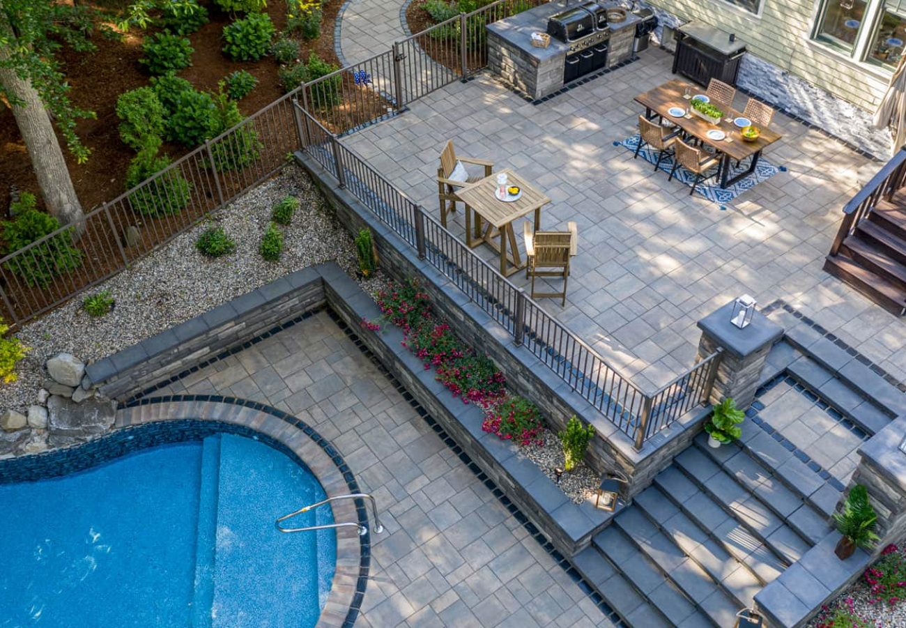Unilock Patio and Pool Deck, with Beacon Hill Flagstone and U-Cara wall
