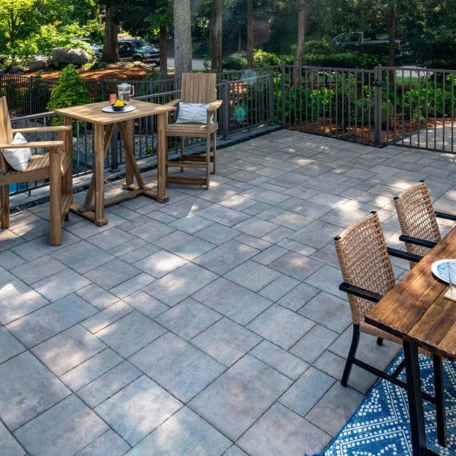 Unilock Elevated Patio and Eating Area, with Beacon Hill Flagstone and U-Cara wall