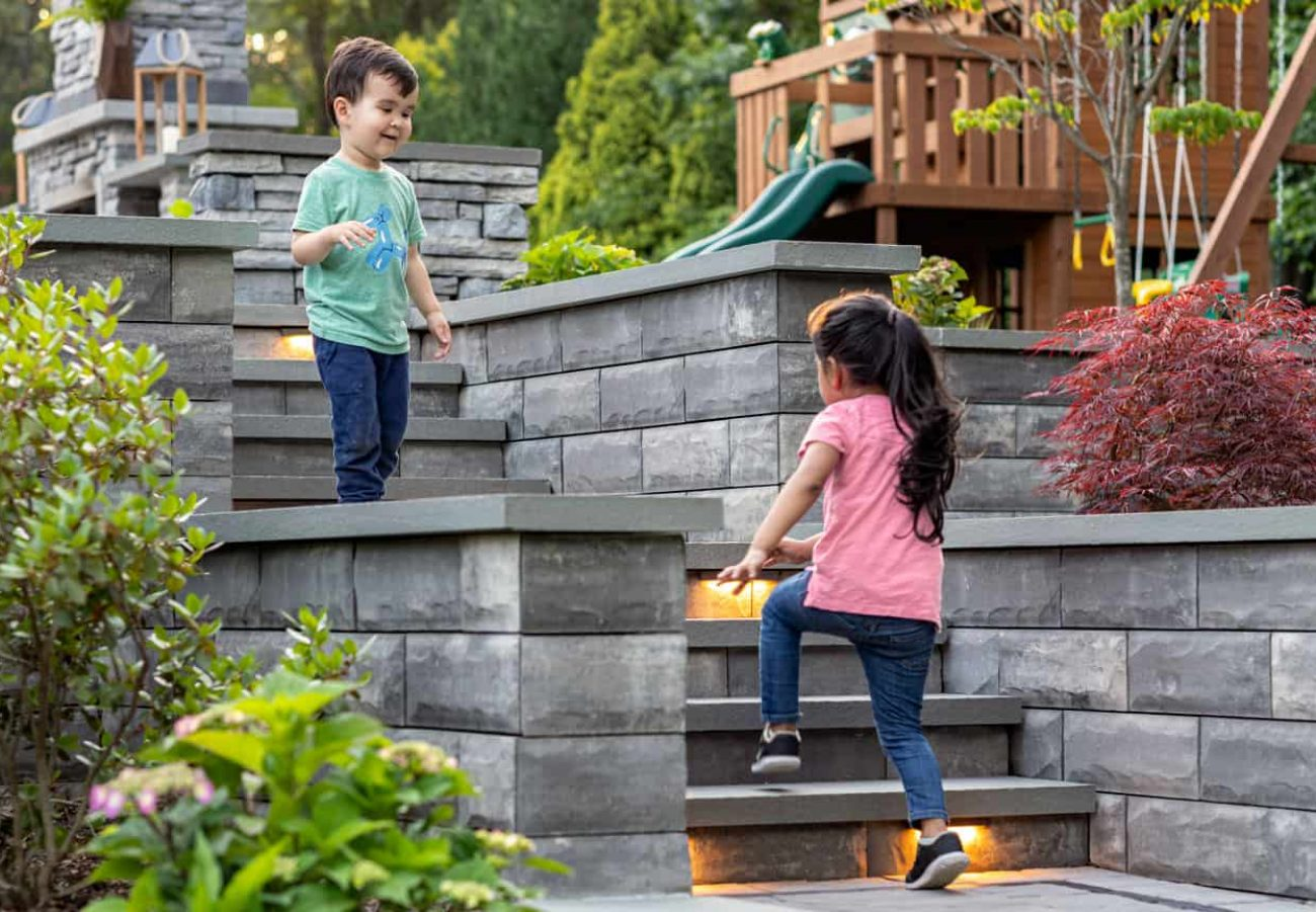 Kids running up steps built with U-Cara Wall