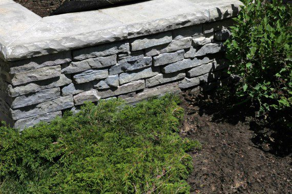 Building a Retaining Wall That Complements a Nature-Inspired Landscape Design in Albany, NY