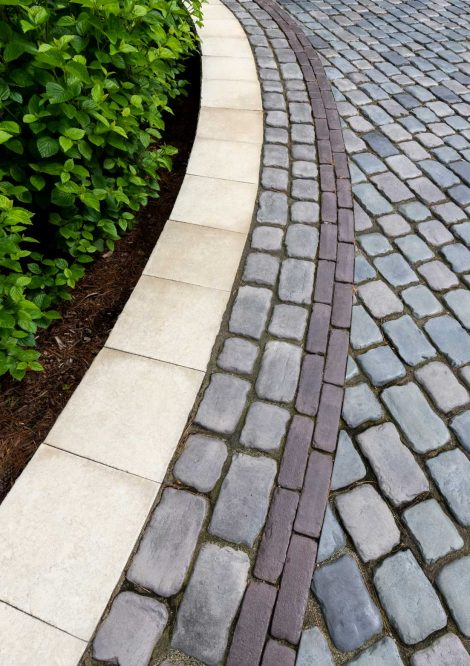 Beauty shot of Courtstone driveway with a Copthorne accent