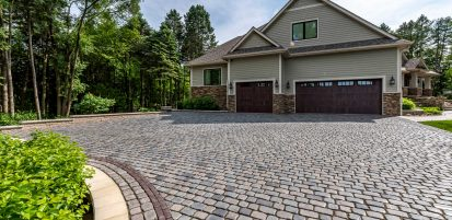 Heated Courtstone driveway with Ledgestone wall