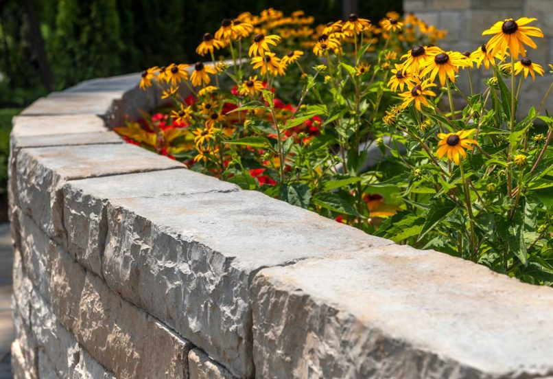 Beauty shot of a curved retaining wall made with Mackinaw